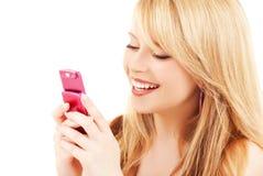 Adolescente feliz con el teléfono celular Imagen de archivo libre de regalías