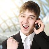 Adolescente feliz con el teléfono móvil Imágenes de archivo libres de regalías