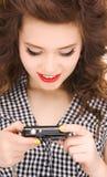 Adolescente feliz con la cámara digital Imagen de archivo