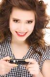 Adolescente feliz con la cámara digital Imagen de archivo libre de regalías
