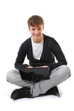 Adolescente feliz con la computadora portátil aislada Foto de archivo libre de regalías