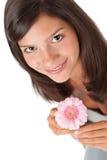 Adolescente feliz con la margarita del gerber Foto de archivo