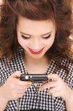 Adolescente feliz con las cámaras digitales Imagen de archivo