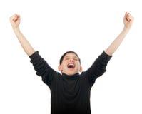 Adolescente feliz con las manos en el aire que grita Imagenes de archivo