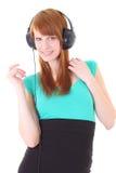 Adolescente feliz con los auriculares en alineada Fotografía de archivo libre de regalías