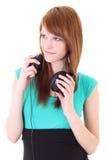 Adolescente feliz con los auriculares en alineada Fotos de archivo