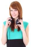 Adolescente feliz con los auriculares en alineada Fotos de archivo libres de regalías