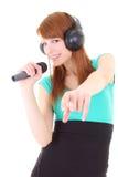 Adolescente feliz con los auriculares y el micrófono Imágenes de archivo libres de regalías