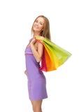 Adolescente feliz con los bolsos de compras Fotografía de archivo