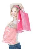 Adolescente feliz con los bolsos de compras rosados Foto de archivo