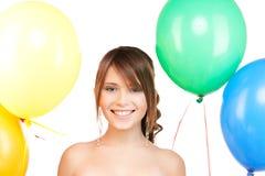 Adolescente feliz con los globos Foto de archivo libre de regalías