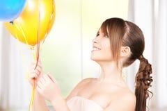 Adolescente feliz con los globos Imagenes de archivo