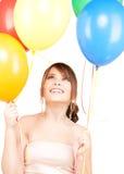 Adolescente feliz con los globos Fotografía de archivo