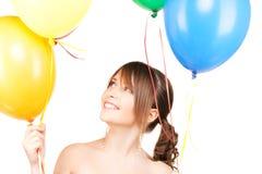 Adolescente feliz con los globos Fotos de archivo