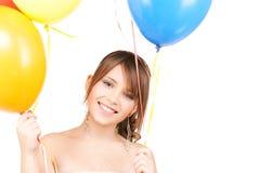 Adolescente feliz con los globos Imágenes de archivo libres de regalías
