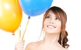 Adolescente feliz con los globos Foto de archivo