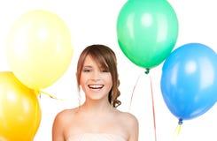Adolescente feliz con los globos Fotografía de archivo libre de regalías