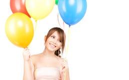 Adolescente feliz con los globos Imagen de archivo libre de regalías