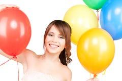 Adolescente feliz con los globos Fotos de archivo libres de regalías
