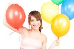 Adolescente feliz con los globos Imagen de archivo