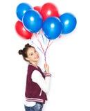 Adolescente feliz con los globos del helio Foto de archivo