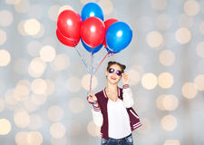 Adolescente feliz con los globos del helio Imagen de archivo