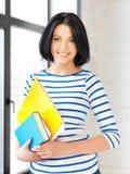 Adolescente feliz con los libros y las carpetas Fotografía de archivo libre de regalías