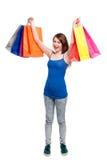 Adolescente feliz con los panieres coloreados brillantes Imágenes de archivo libres de regalías