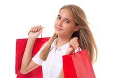 Adolescente feliz con los panieres rojos Aislado Imagen de archivo libre de regalías