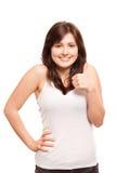 Adolescente feliz con los pulgares para arriba Foto de archivo libre de regalías