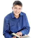Adolescente feliz con un libro Fotos de archivo libres de regalías