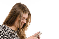 Adolescente feliz con un teléfono móvil Fotos de archivo