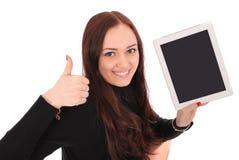 Adolescente feliz del estudiante con la PC de la tableta, deteniendo el pulgar Imagenes de archivo