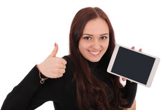 Adolescente feliz del estudiante con la PC de la tableta, deteniendo el pulgar Imagen de archivo