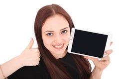 Adolescente feliz del estudiante con PC de la tableta El sentarse de lado y Fotos de archivo libres de regalías