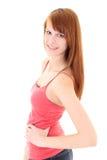Adolescente feliz en camiseta rosada Imagen de archivo