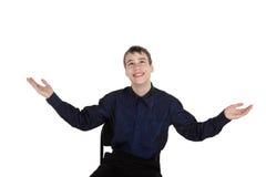 Adolescente feliz en el fondo blanco que mira para arriba Fotografía de archivo
