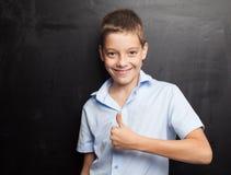 Adolescente feliz en el schoool Foto de archivo libre de regalías