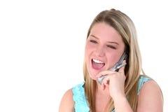 Adolescente feliz en el teléfono celular sobre blanco Imagenes de archivo
