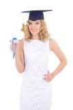 Adolescente feliz en esquina-casquillo con el diploma Imagen de archivo libre de regalías