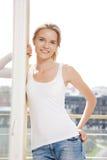 Adolescente feliz en la ventana Fotografía de archivo libre de regalías