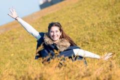 Adolescente feliz en los campos Imagen de archivo libre de regalías