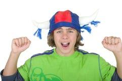 Adolescente feliz en un casco del ventilador Fotografía de archivo