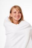 Adolescente feliz en una toalla Fotografía de archivo libre de regalías