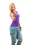 Adolescente feliz hermoso que muestra los pulgares para arriba Imagen de archivo