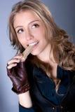 Adolescente feliz joven con la galleta Foto de archivo libre de regalías