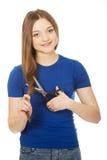 Adolescente feliz que corta su pelo Imagen de archivo libre de regalías