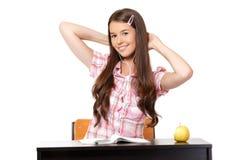 Adolescente feliz que estira en escuela Imagen de archivo libre de regalías
