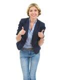 Adolescente feliz que muestra los pulgares para arriba Fotografía de archivo