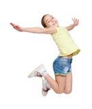 Adolescente feliz que salta en fondo aislado blanco Imágenes de archivo libres de regalías